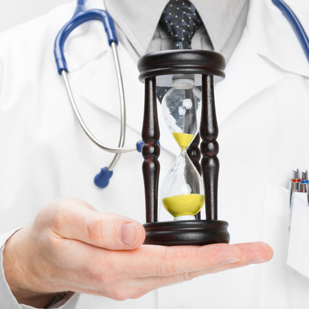 by pass surgery: Medical doctor and hourglass - heath care concept