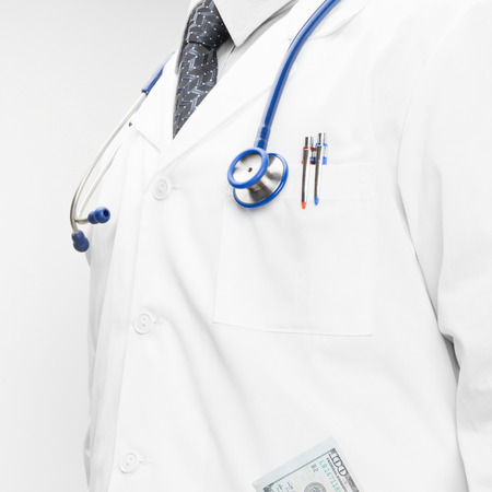 doctor money: Doctor with money in his pocket