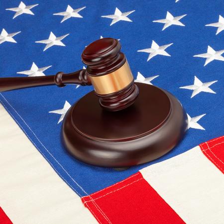 international criminal court: Judge gavel over US flag - closeup studio shot