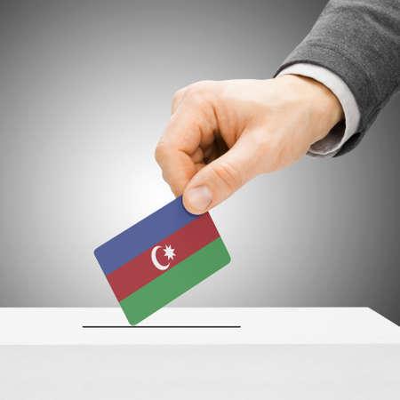 political system: Voting concept - Male inserting flag into ballot box - Azerbaijan Stock Photo