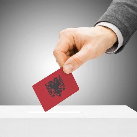 Voting concept - Male inserting flag into ballot box - Albania photo