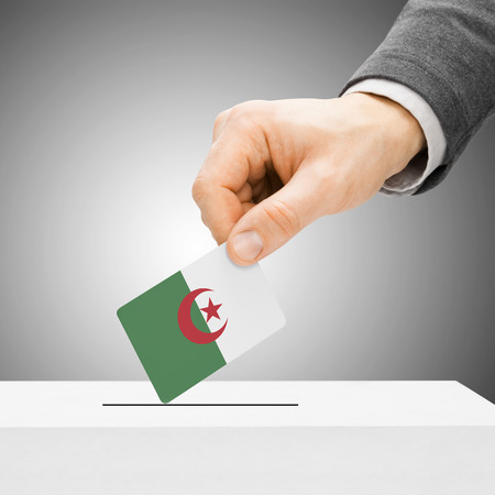 Voting concept - Male inserting flag into ballot box - Algeria Stock Photo - 36736610