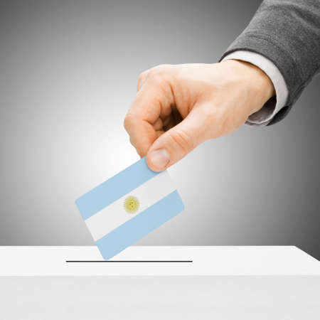 Voting concept - Male inserting flag into ballot box - Argentina photo