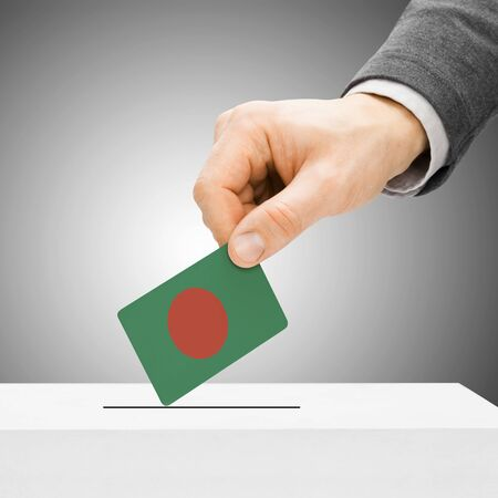 political system: Voting concept - Male inserting flag into ballot box - Bangladesh Stock Photo