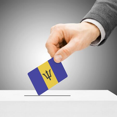 electoral system: Voting concept - Male inserting flag into ballot box - Barbados