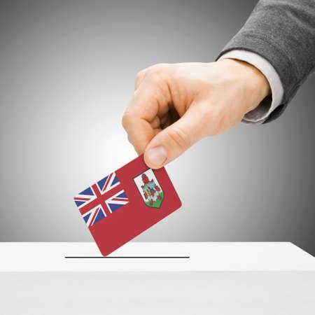 electoral system: Voting concept - Male inserting flag into ballot box - Bermuda