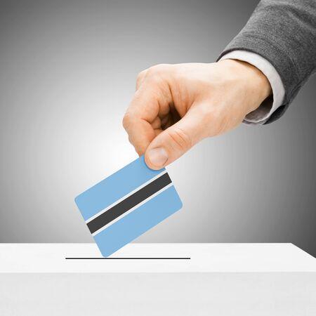 botswanan: Voting concept - Male inserting flag into ballot box - Botswana
