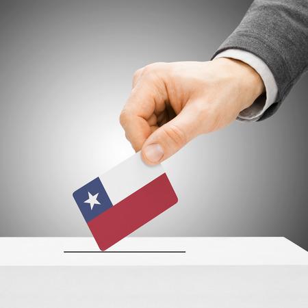 Voting concept - Male inserting flag into ballot box - Chile photo