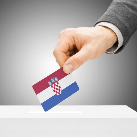 Voting concept - Male inserting flag into ballot box - Croatia