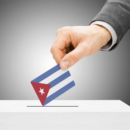 Voting concept - Male inserting flag into ballot box - Cuba photo