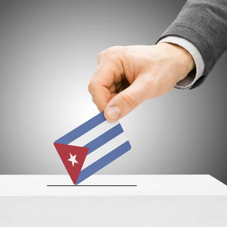 electoral system: Voting concept - Male inserting flag into ballot box - Cuba