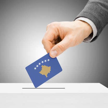 Voting concept - Male inserting flag into ballot box - Kosovo
