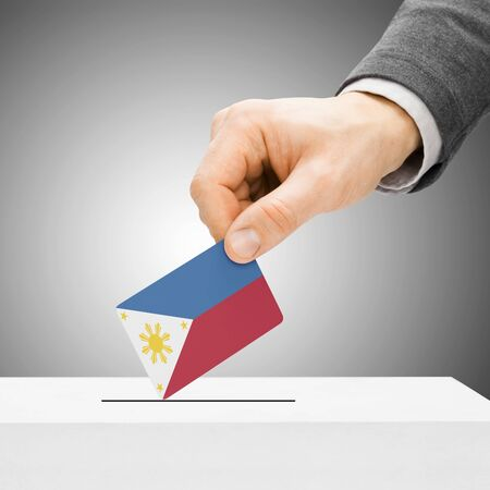 Voting concept - Male inserting flag into ballot box - Philippines photo