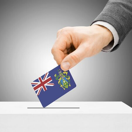 polling booth: Voting concept - Male inserting flag into ballot box - Pitcairn Island