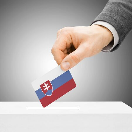 plebiscite: Voting concept - Male inserting flag into ballot box - Slovakia Stock Photo
