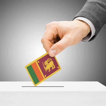 plebiscite: Voting concept - Male inserting flag into ballot box - Sri Lanka