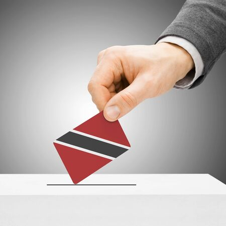 Voting concept - Male inserting flag into ballot box - Trinidad and Tobago
