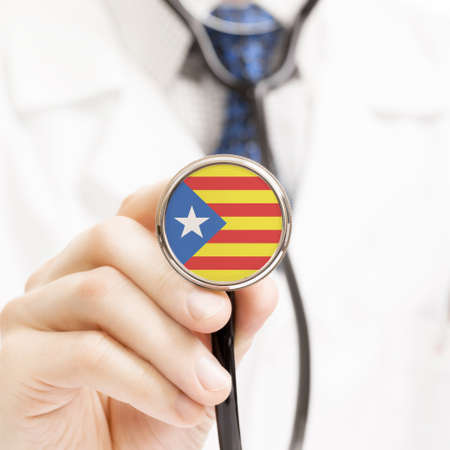National flag on stethoscope conceptual series - Estelada - Catalonia - Spain photo