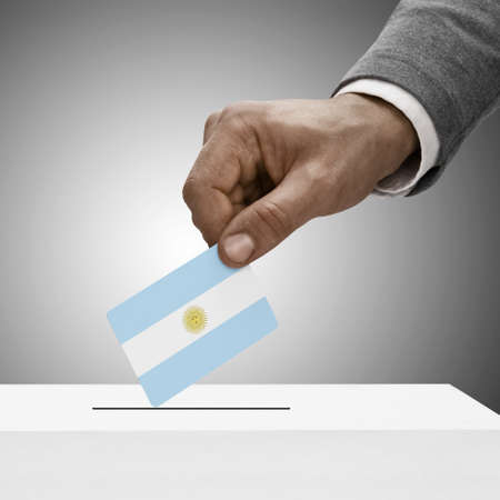 Black male holding Argentina flag. Voting concept  photo
