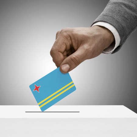 aruba flag: Black male holding Aruba flag. Voting concept