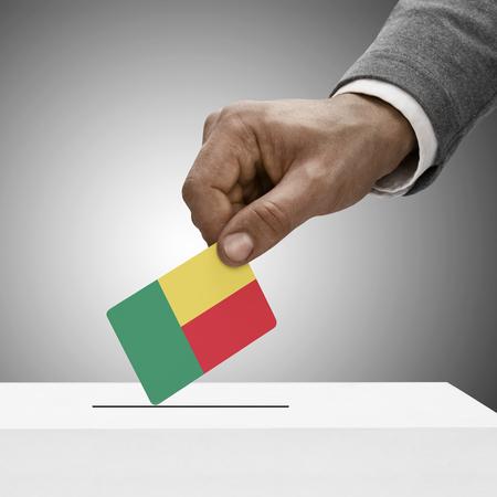 electoral system: Black male holding flag. Voting concept - Benin