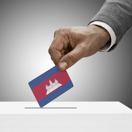 electoral system: Black male holding Cambodia flag. Voting concept