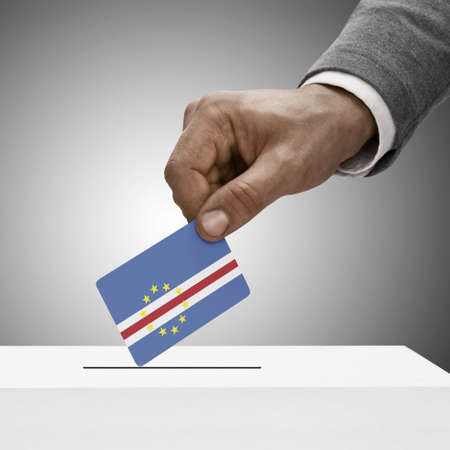 cape verde flag: Black male holding Cape Verde flag. Voting concept Stock Photo