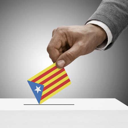 Black male holding Estelada - Catalan Republic flag. Voting concept Stock Photo