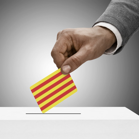 Black male holding Catalonia flag. Voting concept