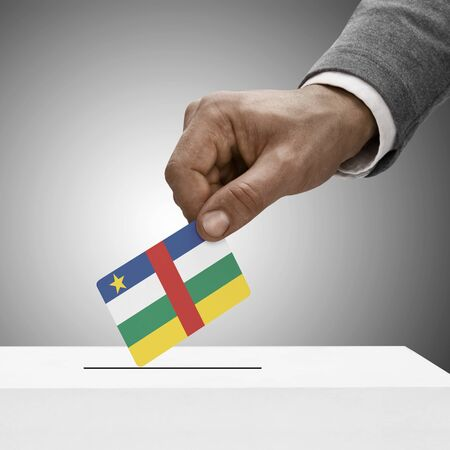 electoral system: Black male holding Central African Republic flag. Voting concept