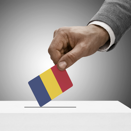 chad flag: Black male holding Republic of Chad flag. Voting concept Stock Photo