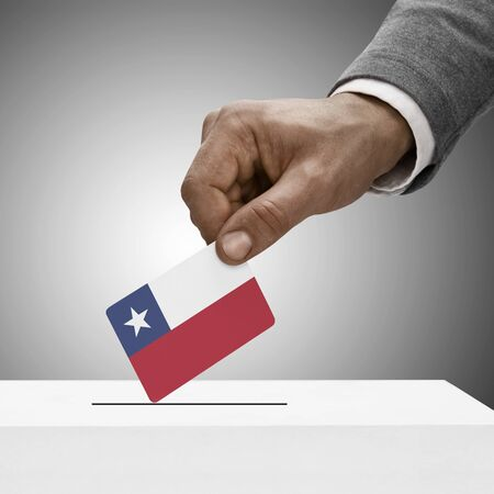 Black male holding flag. Voting concept - Republic of Chile photo