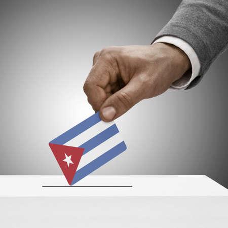 Black male holding Cuba flag. Voting concept photo