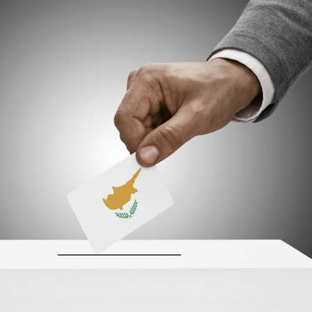 political system: Black male holding Republic of Cyprus flag. Voting concept