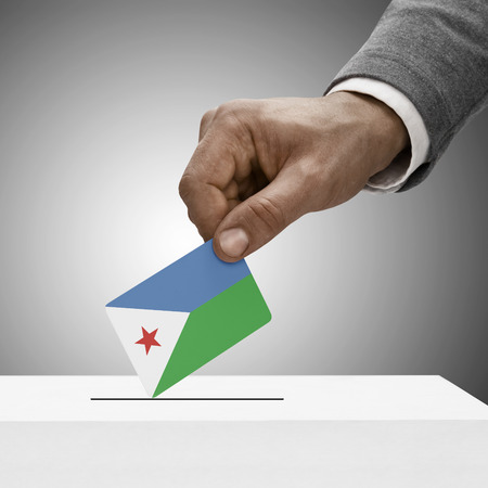 electoral system: Black male holding Djibouti flag. Voting concept Stock Photo