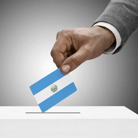 el salvador flag: Black male holding Republic of El Salvador flag. Voting concept