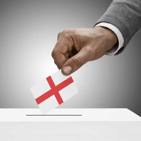 political system: Black male holding England flag. Voting concept