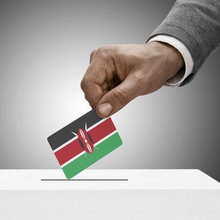 Black male holding Kenya flag. Voting concept photo