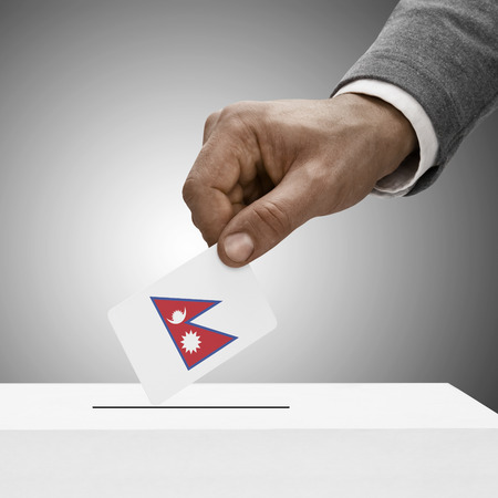 electoral system: Black male holding Nepal flag. Voting concept