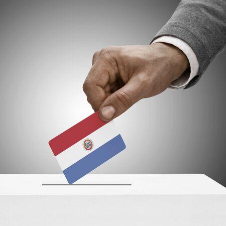 electoral system: Black male holding flag. Voting concept - Paraguay