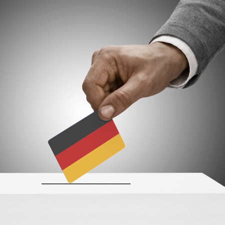 Black male holding Germany flag. Voting concept photo