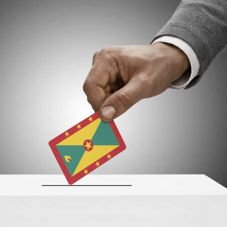polling booth: Black male holding Grenada flag. Voting concept