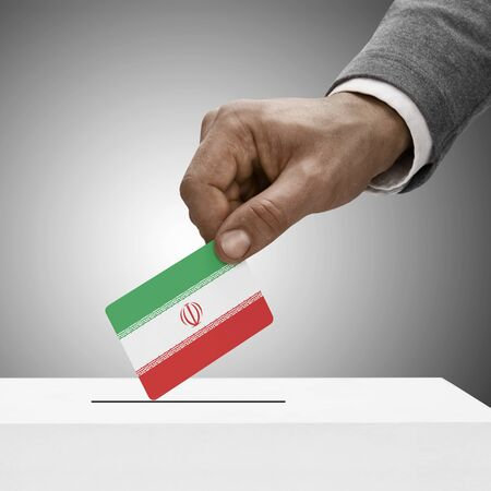 Black male holding flag. Voting concept - Iran photo