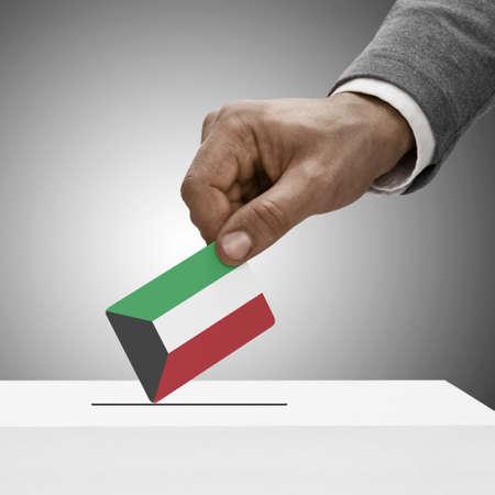 electoral system: Black male holding Kuwait flag. Voting concept