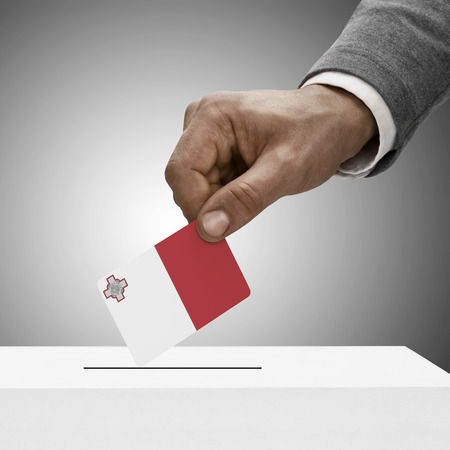 plebiscite: Black male holding Malta flag. Voting concept