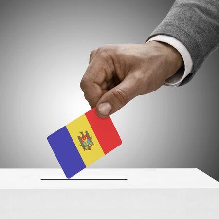 electoral system: Black male holding Moldova flag. Voting concept