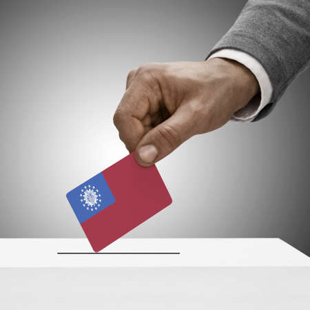 plebiscite: Black male holding Republic of the Union of Myanmar flag. Voting concept
