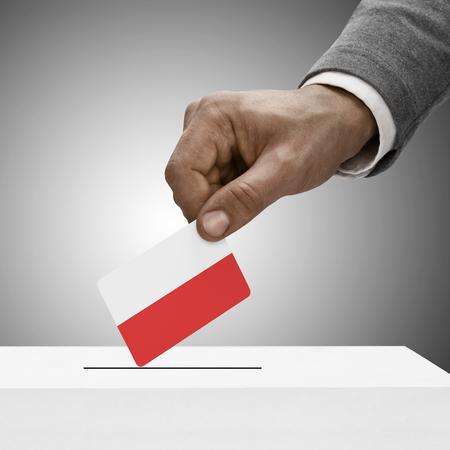 Black male holding Poland flag. Voting concept photo