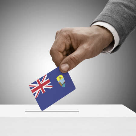 helena: Black male holding Saint Helena flag. Voting concept