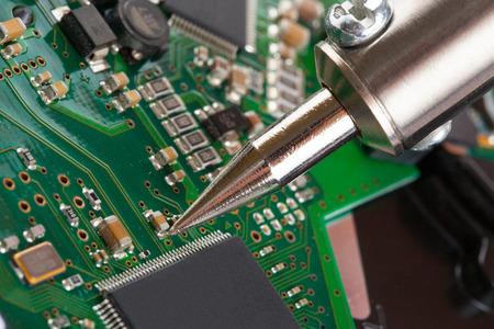 microcircuit: Soldering iron and microcircuit - closeup studio shot Stock Photo